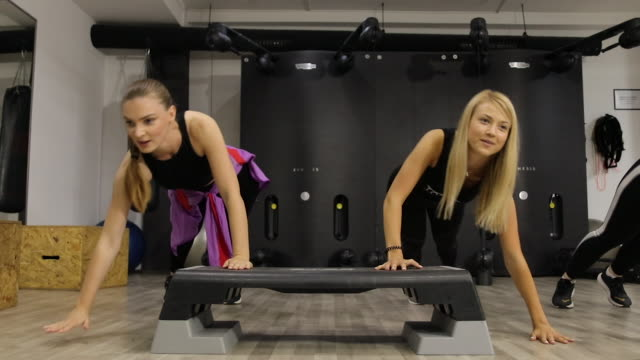 female athletes exercising together during exercise class at gym - bodyweight training stock videos & royalty-free footage