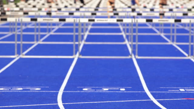 MS Female Athletes in Hurdle Race