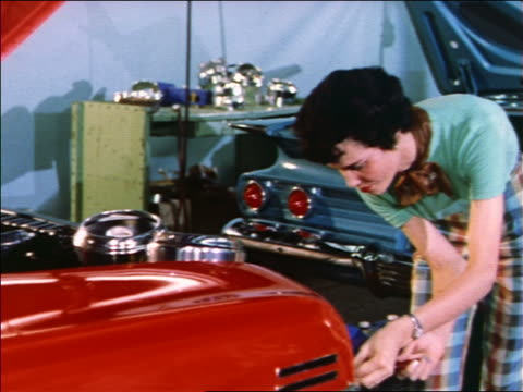 1959 female auto worker assembling cars on assembly line / 1960 chevy - 1950 1959 stock videos & royalty-free footage