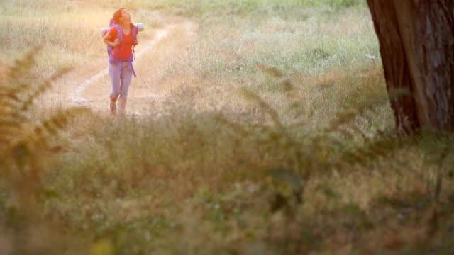 Female backpack traveler in nature
