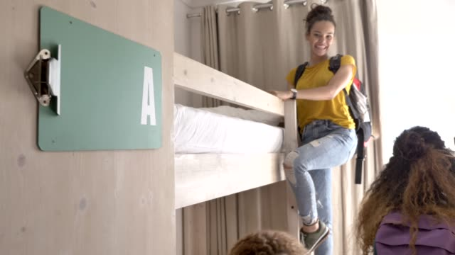 female backpackers sitting on bunkbeds in hotel - dorm room stock videos and b-roll footage