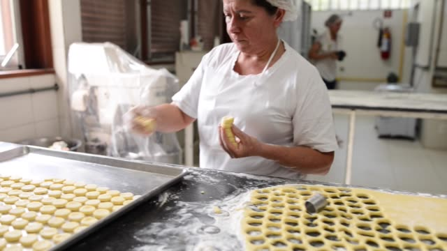 female baker at work - small stock videos & royalty-free footage