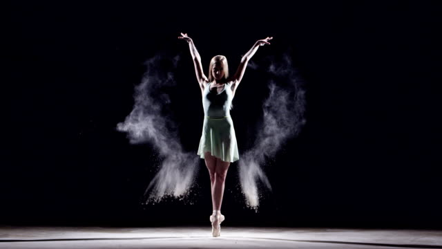 female ballet dancer on her toes - dance studio stock-videos und b-roll-filmmaterial