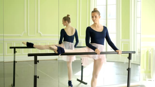 female ballet dancer stretches and practices using the barre - barre stock videos & royalty-free footage