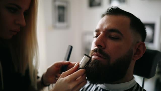 female barber creates nice beard - barber shop stock videos and b-roll footage