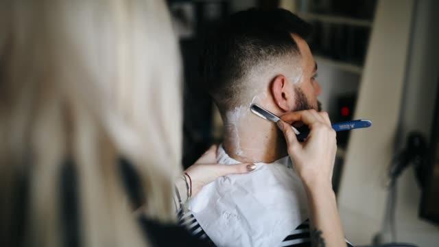 female barber creates nice beard - barber stock videos and b-roll footage