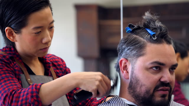 ms female barber shop owner trimming mans hair in barber shop - gingham stock videos & royalty-free footage