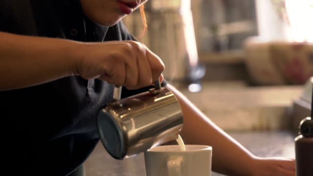 female barista makes latte/cappuccinno - pride stock videos & royalty-free footage