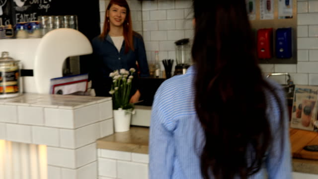 female barista taking order from customer at cafe - entering stock videos & royalty-free footage