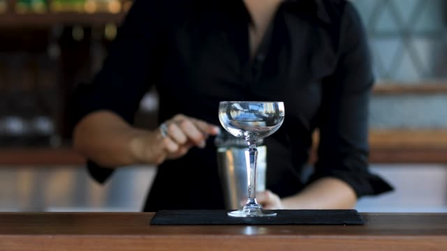 female bartender making cocktails - cocktail stock videos & royalty-free footage