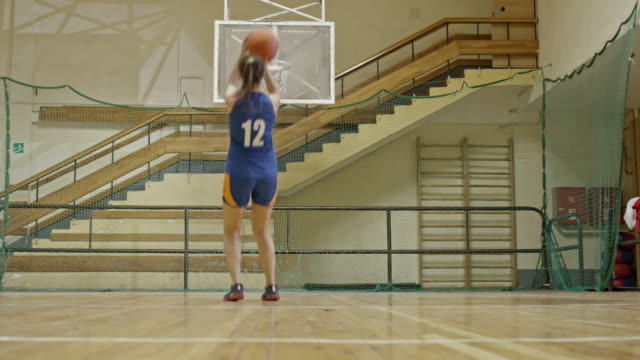 female basketball athlete practicing free throw - taking a shot sport stock videos & royalty-free footage