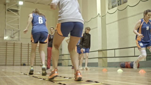 Female basketball athletes working out