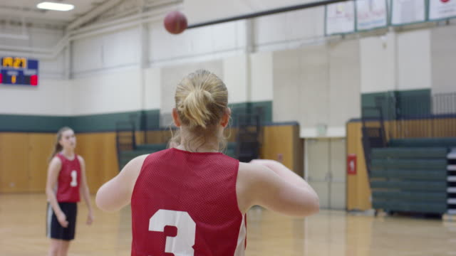 female basketball player catching and passing the ball - 18 19 years stock videos & royalty-free footage