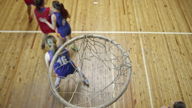 female basketball player performing successful shot during game - net sports equipment stock videos & royalty-free footage