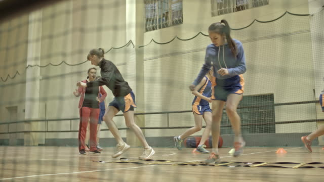 female basketball players doing footwork exercises - whistle stock videos & royalty-free footage