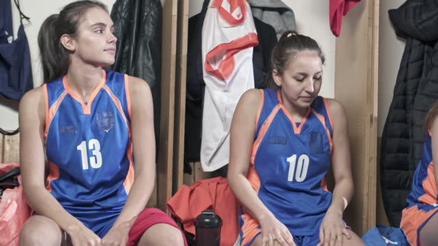 Female basketball players going from locker room