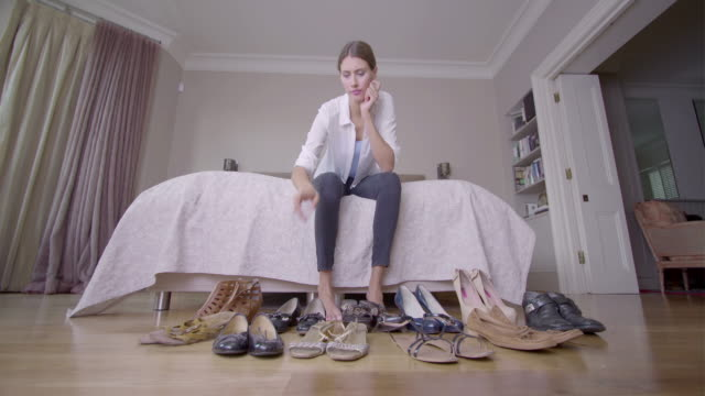 Female beauty at home choosing shoes