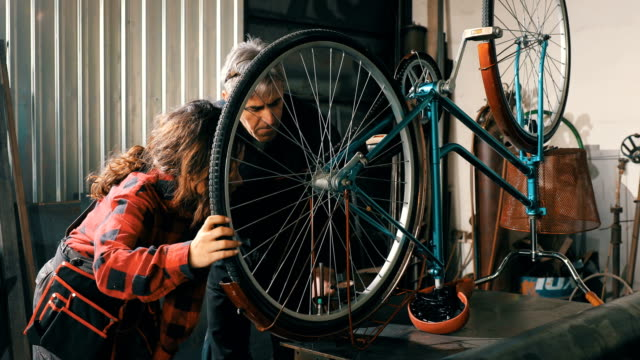 female bicycle mechanic - repairing stock videos and b-roll footage