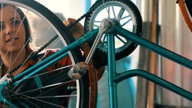 female bicycle mechanic - repair shop stock videos & royalty-free footage
