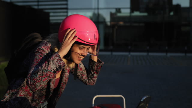 female biker adjusting crash helmet - crash helmet stock videos & royalty-free footage