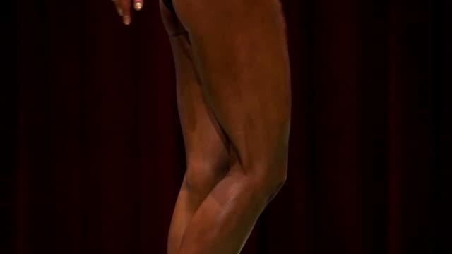 Female Body builder posing at bodybuilder championship