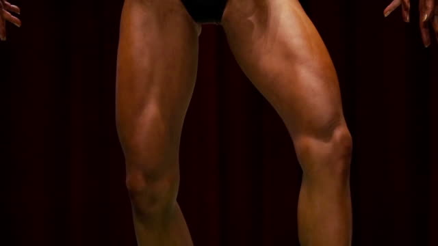 female body builder posing at bodybuilder championship - body building stock videos & royalty-free footage