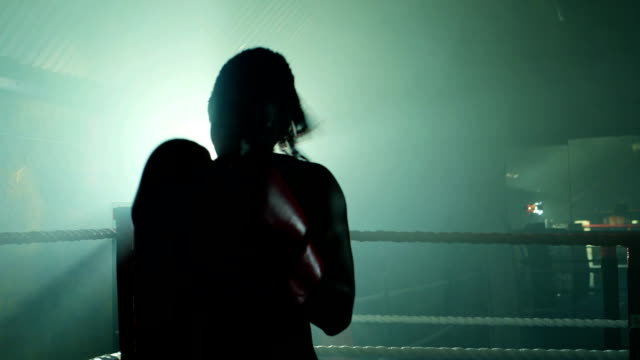 female boxer fighting in boxing ring. - boxing ring stock videos & royalty-free footage