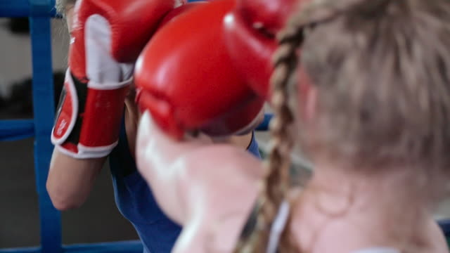 Female boxer getting punched in the face