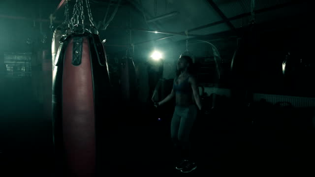 MLS Female Boxer jumping rope.