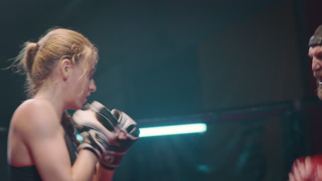 female boxer pad work session with trainer - combat sport stock videos & royalty-free footage