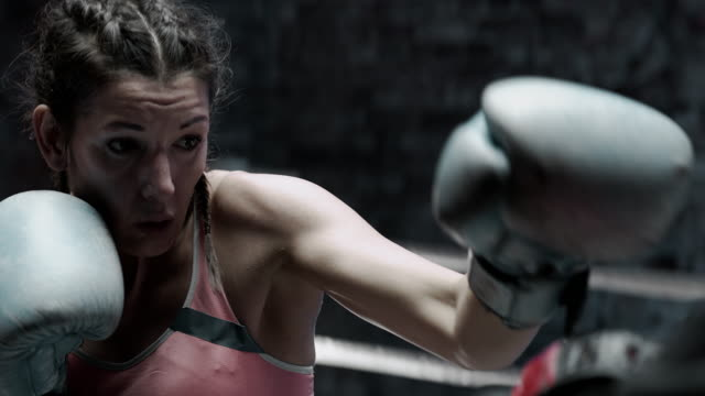 female boxer pad work session with trainer - sportsperson stock videos & royalty-free footage