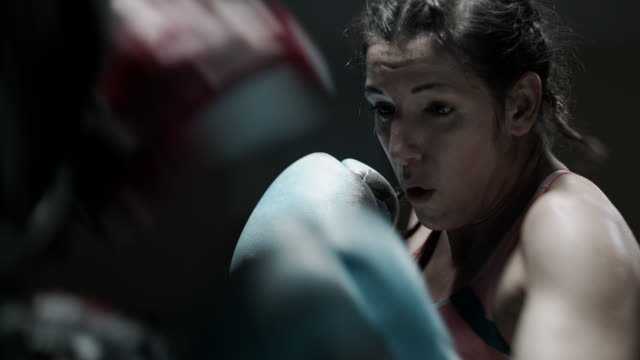 female boxer pad work session with trainer - sport stock videos & royalty-free footage