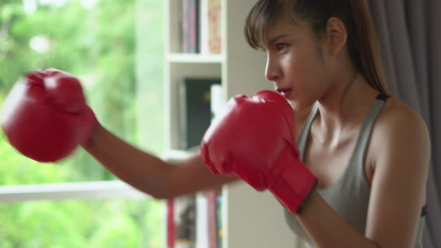 female boxer practising boxing at home - boxing stock videos & royalty-free footage