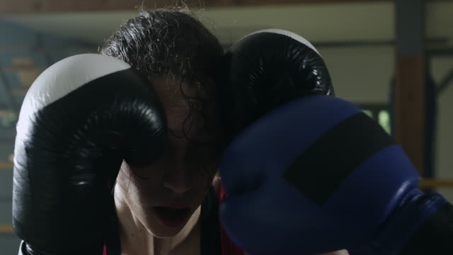 female boxer protecting head in the boxing ring - boxing sport stock videos and b-roll footage