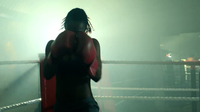 MS of Female Boxer punching.