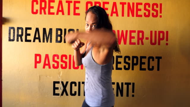 MS Female boxer shadow boxing gym