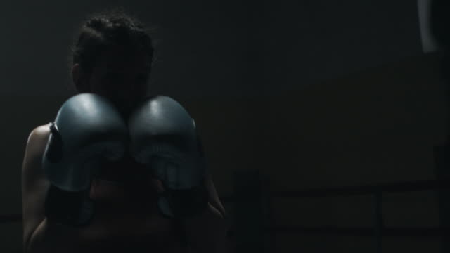 female boxer sparring with her trainer - resting stock videos & royalty-free footage