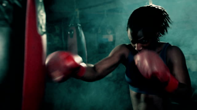 stockvideo's en b-roll-footage met ms female boxer training. - stootzak fitnessapparatuur
