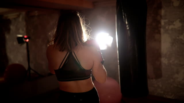female boxer training with a punching bag - self defense stock videos and b-roll footage