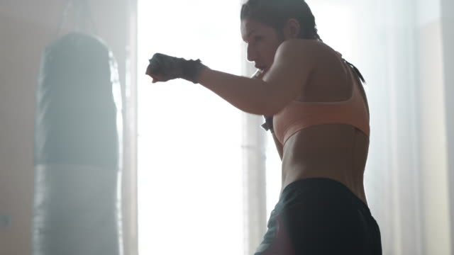 female boxer working out alone - punch bag stock videos & royalty-free footage