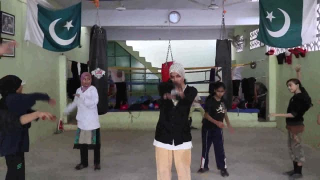 female boxers are in training with their coach to prepare women boxing tournament in karachi, pakistan on november 03, 2016. pakistan women boxing... - boxing women's stock videos & royalty-free footage