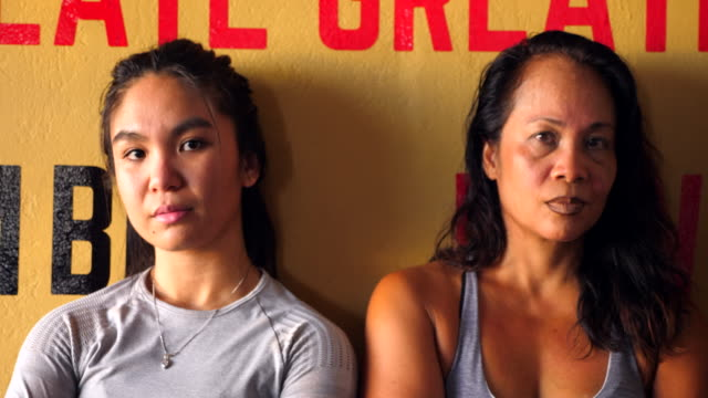 cu female boxers posing for photo after training session in boxing gym - pacific islanders stock videos & royalty-free footage
