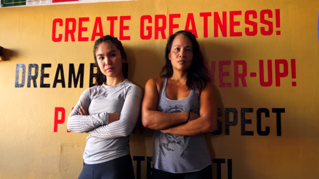 ms female boxers posing for photo after training session in boxing gym - western script stock videos & royalty-free footage