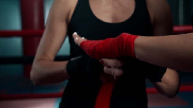 female boxers preparing for fight - bandage stock videos & royalty-free footage