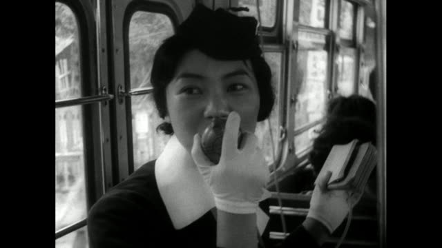 female bus conductor talks to passengers on bus; 1962 - bbc archive stock-videos und b-roll-filmmaterial