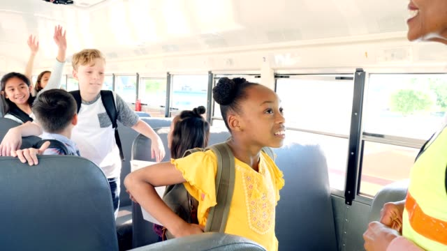 female bus driver gives instructions to students - field trip stock videos & royalty-free footage