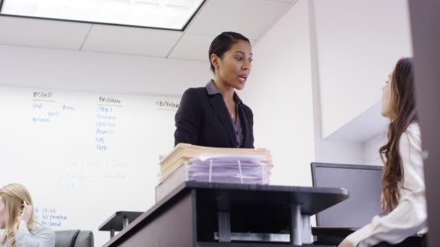 female business executive working with her team in the office - employee engagement stock videos & royalty-free footage