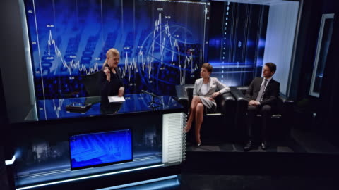 cs female business talk show host doing the introduction with two guests sitting next to her in the studio - television show stock videos & royalty-free footage