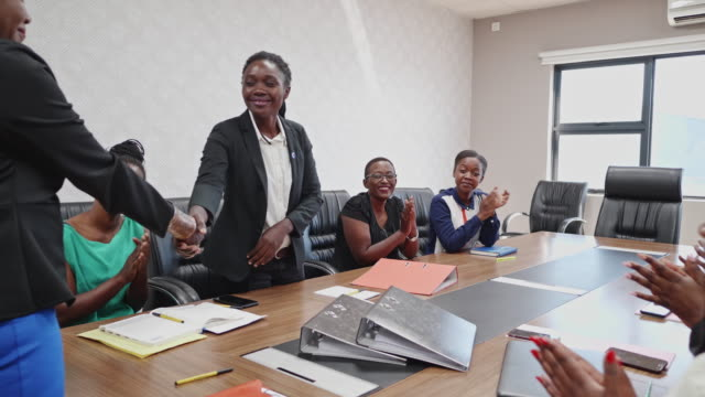 female businesswoman congratulating her employee of the month - zambia stock videos & royalty-free footage