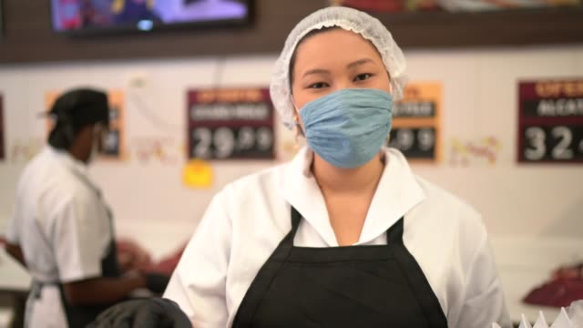 female butcher talking to customer at butcher's shop - personal perspective - apron stock videos & royalty-free footage